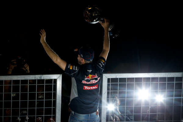 Suzuka Circuit, Suzuka, Japan.  Sunday 13th October 2013.  Sebastian Vettel, Red Bull Racing, 1st position, celebrates with the crowd. World Copyright: Glenn Dunbar/LAT Photographic  ref: Digital Image _G7C1704