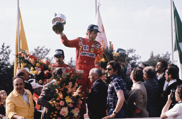 Zolder, Belgium. 14th - 16th May 1976. Niki Lauda (Ferrari 312T2), 1st position, celebrates with Clay Regazzoni (Ferrari 312T2), 2nd position and Jacques Laffite (Ligier JS5-Matra), 3rd position on the podium, portrait.  World Copyright: LAT Photographic. Ref:  76 BEL 27.