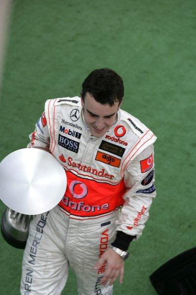 2007 Malaysian Grand Prix - Sunday RaceSepang, Kuala Lumpur. Malaysia.8th April 2007.Fernando Alonso, McLaren MP4-22 Mercedes, 1st  position, celebrates on the podium. Podiums, Portrait. World Copyright: Steven Tee/LAT Photographic.ref: Digital Image YY2Z7679A