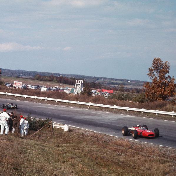 Watkins Glen, New York, USA.30/9-2/10 1966.Lorenzo Bandini (Ferrari 312) leads Jack Brabham (Brabham BT20 Repco).Ref-3/2561.World Copyright - LAT Photographic