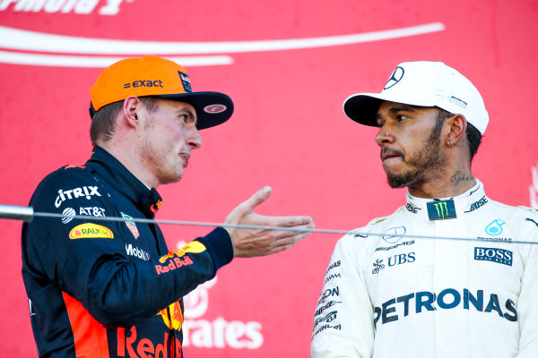Suzuka Circuit, Japan. Sunday 8 October 2017. Max Verstappen, Red Bull, 2nd Position, and Lewis Hamilton, Mercedes AMG, 1st Position, on the podium. World Copyright: Charles Coates/LAT Images  ref: Digital Image DJ5R1536