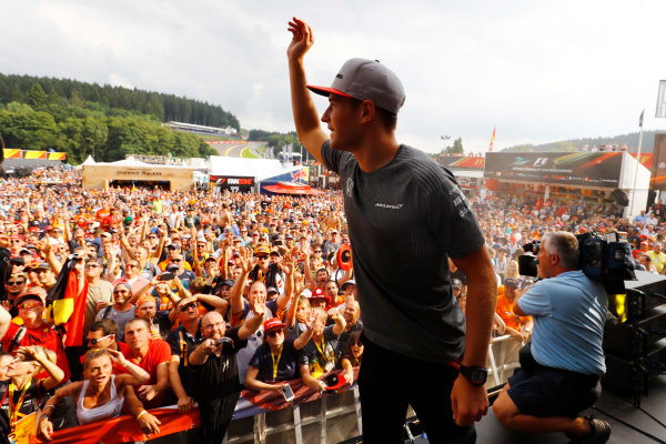 Spa Francorchamps, Belgium.  Saturday 26 August 2017. Stoffel Vandoorne, McLaren, throws hats in to the crowd from the F1 Fanzone stage. World Copyright: Steven Tee/LAT Images  ref: Digital Image _R3I0487