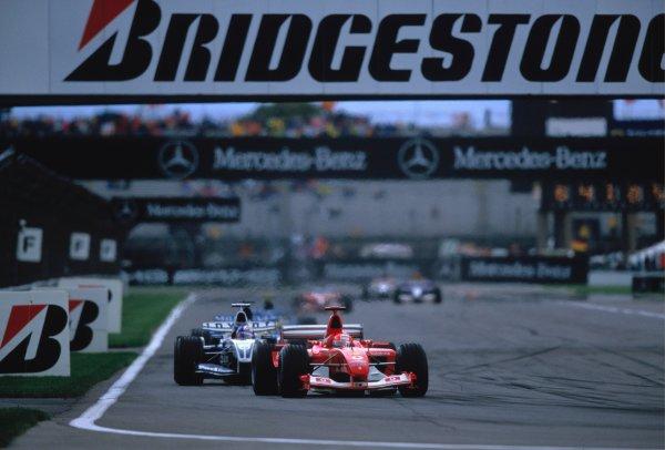 2003 United States Grand PrixIndianapolis, USA. 26th - 28th October 2003Michael Schumacher, Ferrari F2003 GA, leads JUAN-PABLO MONTOYA, BMW WILLIAMS FW25World Copyright: Peter Spinney / LAT Photographic ref: 35mm Image 03AMER29