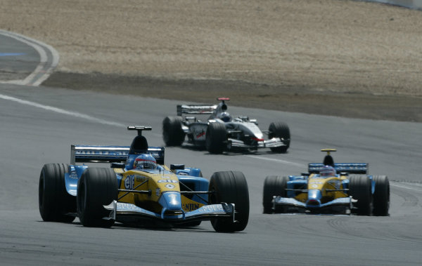 2003 European Grand Prix - Sunday Race,Nurburgring, Germany. 29th June 2003 Fernando Alonso, Renault R23, leads Jarno Trulli, Renault R23, and David Coulthard, Team McLaren Mercedes MP4-17D, action.World Copyright: Steve Etherington/LAT Photographic ref: Digital Image Only