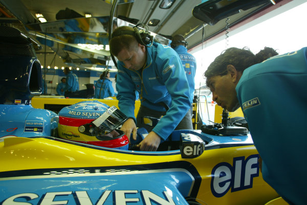 2003 San Marino Grand Prix - Friday 1st Qualifying Imola, Italy. 18th April 2003. Fernando Alonso, Renault R23, in pit garage. World Copyright LAT Photographic. ref: Digital Image Only.