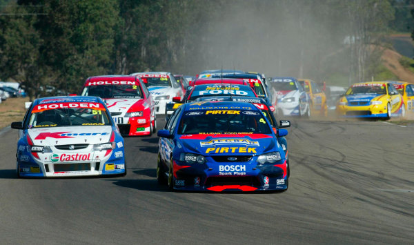2003 Australian V8 SupercarsOran Park, Sydney, Australia. 17th August 2003.Ford driver Marcos Ambrose leads the field into turn 1 at the start of todays 300km race at Sydneys Oran Park. World Copyright: Mark Horsburgh/LAT Photographicref: Digital Image Only