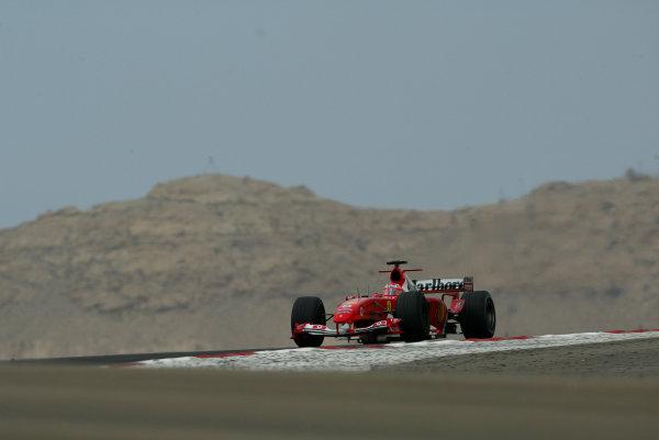 2004 Bahrain Grand Prix - Sunday Race, 2004 Bahrain Grand Prix Bahrain International Circuit, Manama, Bahrain. 4th April 2004 Rubens Barrichello, Ferrari F2004. Action. World Copyright: Steve Etherington/LAT Photographic ref: Digital Image Only