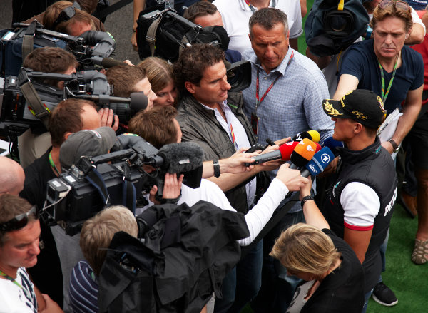 Spa-Francorchamps, Spa, Belgium 25th August 2011. Michael Schumacher, Mercedes GP W02, gets swamped with microphones by the press. Portrait. Media.  World Copyright: Steve Etherington/LAT Photographic ref: Digital Image SNE26338