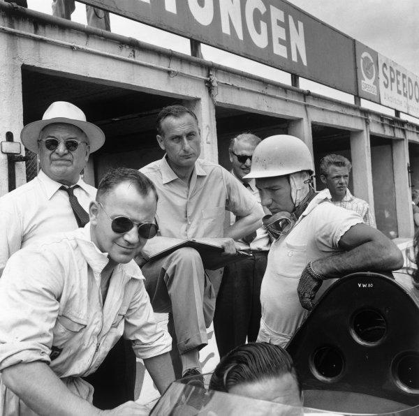 Nurburgring, Germany. 1st June 1958.Stirling Moss / Jack Brabham (Aston Martin DBR1), 1st position, pit lane, portrait.World Copyright: LAT Photographic.Ref: 1641.