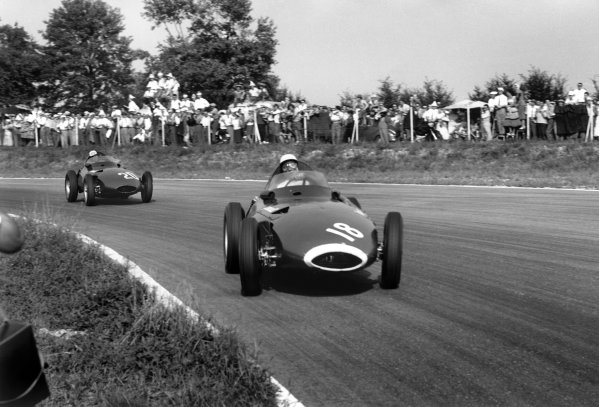 Monza, Italy. 6th - 8th September 1957.Stirling Moss (Vanwall), 1st position, leads Stuart Lewis-Evans (Vanwall), retired, action.World Copyright: LAT PhotographicRef: 490 - 4.