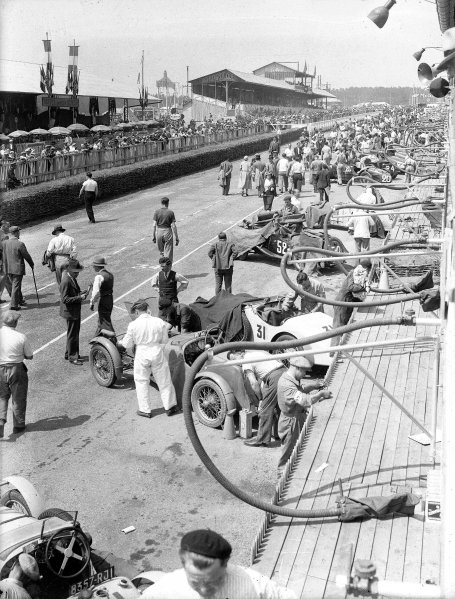 Le Mans, France. 16-17 June 1934.The pits before the race with the cars of Camille Poire/Gaston Robail (Amilcar C6, number 31), Anne-Rose Itier/Charles Duruy (MG Midget PA, number 52), Reggie Tongue/Maurice Faulkner (Aston Martin Ulster, number 20) and John Cecil Noel/JCN Wheeler (Aston Martin Ulster, number 24) among the line-up.Ref-Motor 800/72.World Copyright - LAT Photographic
