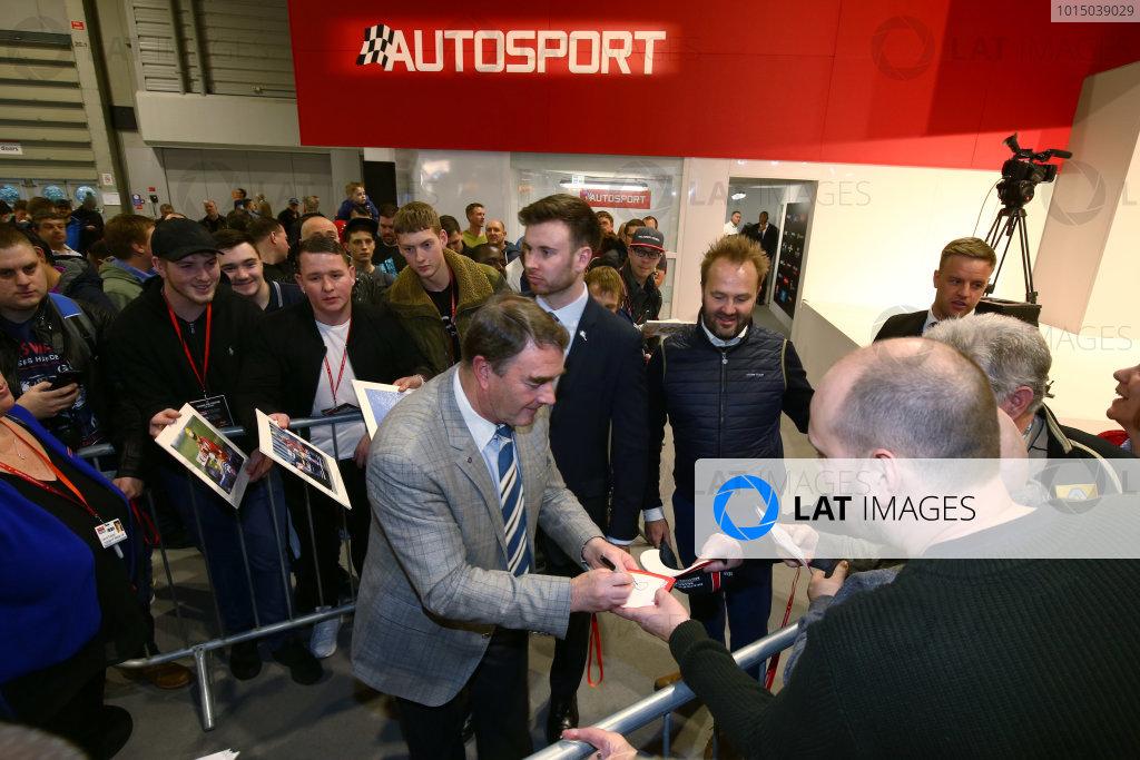 Autosport International Exhibition. National Exhibition Centre, Birmingham, UK. Sunday 14th January 2018. Nigel Mansell signs autographs.World Copyright: Mike Hoyer/JEP/LAT Images Ref: AQ2Y0010