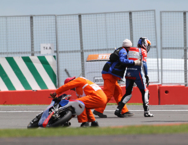 British Grand Prix.  Silverstone, England. 15th-17th June 2012.  Moto3. Marshals assist Jack Miller, Honda, after he crashes out.  World Copyright: Kevin Wood/LAT Photographic.  ref: Digital Image IMG_8721a
