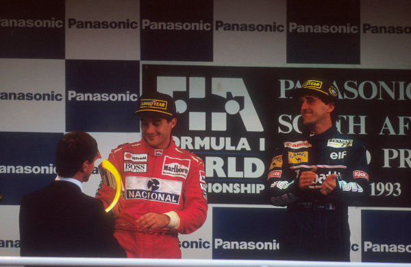 1993 South African Grand Prix.Kyalami, South Africa.12-14 March 1993.Ayrton Senna (McLaren Ford) 2nd position and Alain Prost (Williams Renault) 1st position on the podium.Ref-93 SA 05.World Copyright - LAT Photographic