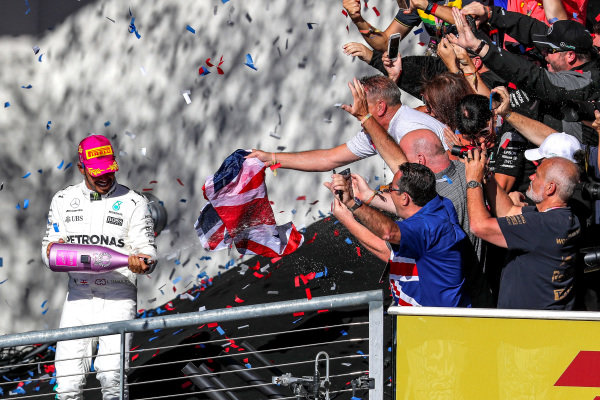 Race winner Lewis Hamilton (GBR) Mercedes AMG F1 celebrates on the podium with the Champagne and the fans at Formula One World Championship, Rd17, United States Grand Prix, Race, Circuit of the Americas, Austin, Texas, USA, Sunday 22 October 2017.