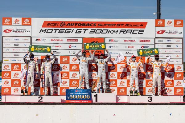 GT500 Winners Naoki Yamamoto & Tadasuke Makino, Stanley Team Kunimitsu, Honda NSX-GT GT500, celebrate on the podium. Alongside are Yuji Kunimoto & Ritomo Miyata, TGR WedsSport Bandoh ADVAN, Toyota GR Supra, 2nd, and Yuhi Sekiguchi & Sho Tsuboi, TGR Team au TOM'S, Toyota GR Supra GT500, 3rd in GT500