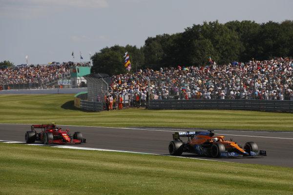 Daniel Ricciardo, McLaren MCL35M, leads Carlos Sainz, Ferrari SF21