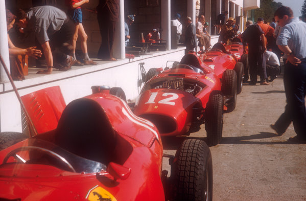 1957 French Grand Prix.Rouen-Les-Essarts, France.5-7 July 1957.The Lancia-Ferrari 801 chassis of the Scuderia Ferrari team line up astern in the pit lane, ready to be worked on.Ref-57 FRA 29.World Copyright - LAT Photographic