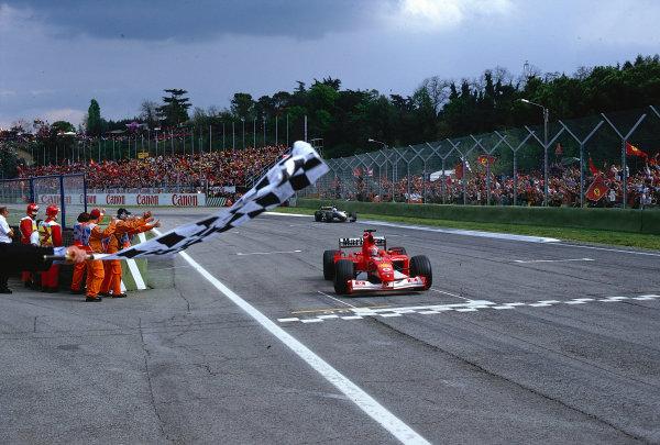 2002 San Marino Grand Prix.Imola, Italy.12-14 April 2002.Michael Schumacher (Ferrari F2002) takes the chequered flag for 1st position.Ref-02 SM 25.World Copyright - LAT Photographic