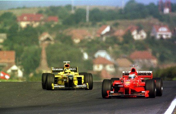 1998 Hungarian Grand Prix.Hungaroring, Budapest, Hungary.14-16 August 1998.Eddie Irvine (Ferrari F300) leads Damon Hill (Jordan 198 Mugen Honda) during qualifying.World Copyright - Steve Etherington/LAT Photographic