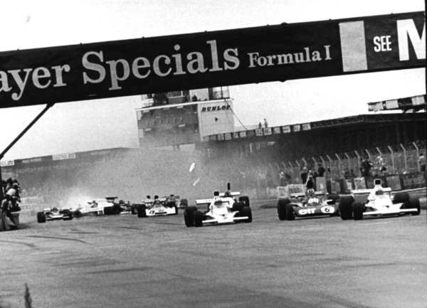 1973 British Grand Prix.Silverstone, England.12-14 July 1973.Jody Scheckter (McLaren M23 Ford) causes the crash at Woodcote at the end of lap 1. Amazingly only Andrea De Adamich was injured.World Copyright - LAT Photographic