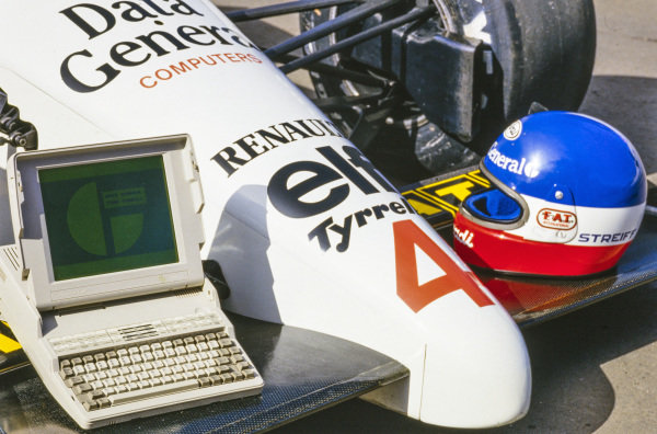 Philippe Streiff's helmet and a computer with the Data General logo on the monitor on the front wing of Streiff's Tyrrell 015 Renault.