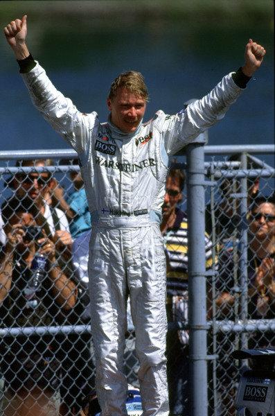 1999 Canadian Grand Prix.Montreal, Quebec, Canada.11-13 June 1999.Mika Hakkinen (McLaren Mercedes-Benz) celebrates his 1st position.Ref-99 CAN 04.World Copyright - LAT Photographic