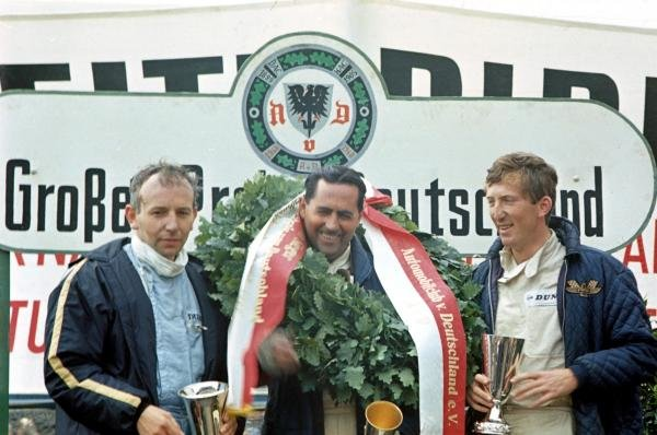 (left to right) 2nd placed John Surtees (GBR) Cooper, race winner Jack Brabham (AUS) Brabham and 3rd placed Jochen Rindt (AUT) Cooper. German Grand Prix, Nurburgring, Germany, 7 August 1966