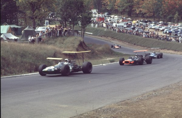 1968 Canadian Grand Prix.Mont-Tremblant, (St. Jovite), Quebec, Canada.20-22 September 1968.Jack Brabham (Brabham BT26 Repco) leads Pedro Rodriguez (BRM P133), Jackie Stewart (Matra MS10 Ford) and Jackie Oliver (Lotus 49B Ford). Rodriguez and Stewart finished in 3rd and 6th positions respectively.Ref-68 CAN 42.World Copyright - LAT Photographic