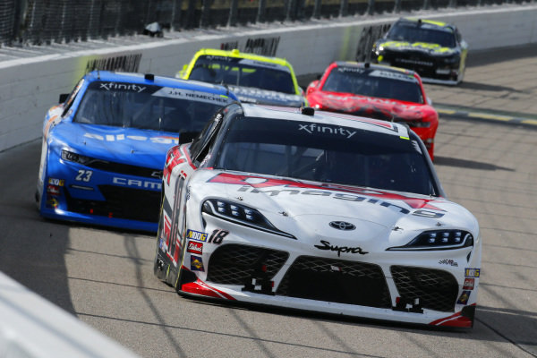 #18: Harrison Burton, Joe Gibbs Racing, Toyota Supra Dex Imaging and #23: John Hunter Nemechek, GMS Racing, Chevrolet Camaro Allegiant