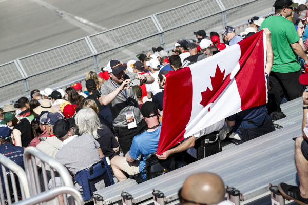 Fans with a Canadian flag
