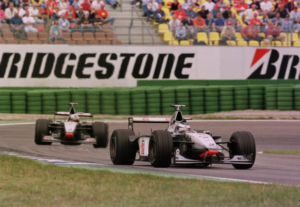 1998 German Grand Prix.Hockenheim, Germany.31/7-2/8 1998.Mika Hakkinen leads David Coulthard (both McLaren MP4/13 Mercedes-Benz). They finished in 1st and 2nd positions respectively.World Copyright - Steve Etherington/LAT Photographic