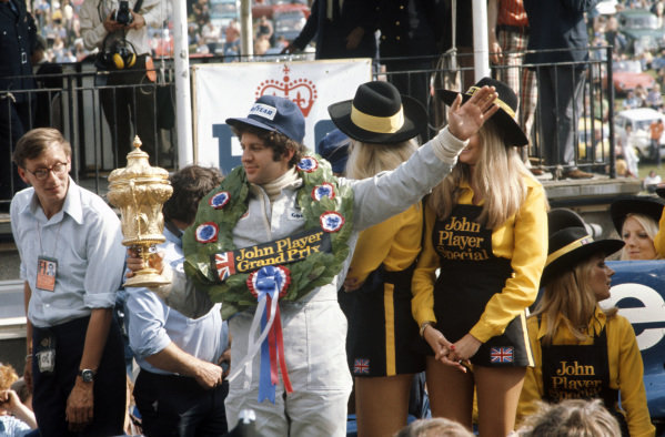 Jody Scheckter celebrates victory on the parade lap.