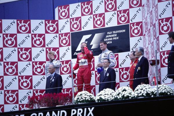 Rubens Barrichello, 1st position, Kimi Räikkönen, 2nd position, David Coulthard, 3rd position, and Jean Todt on the podium.