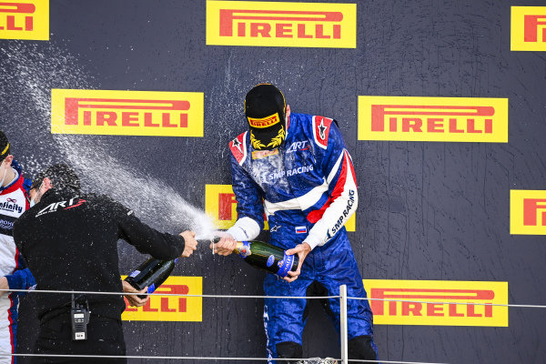 Race Winner Alexander Smolvar (RUS, ART GRAND PRIX) celebrates on the podium with the champagne