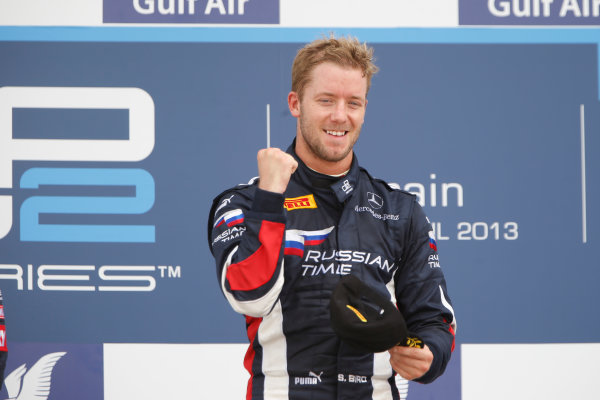 2013 GP2 Series. Round 2.  Bahrain International Circuit, Sakhir, Bahrain. 21st April.  Sunday Race.  Sam Bird (GBR, RUSSIAN TIME) celebrates his victory on the podium.  World Copyright: Glenn Dunbar/GP2 Series Media Service. Ref: _89P4330