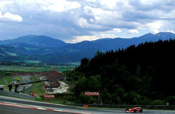 Third place Rubens Barrichello (BRA), Ferrari F2003-GA, with the impressive backdrop of the Austrian Alps in the background. Austrian Grand Prix, Rd6, A1-Ring, Austria. 18 May 2003. BEST IMAGE