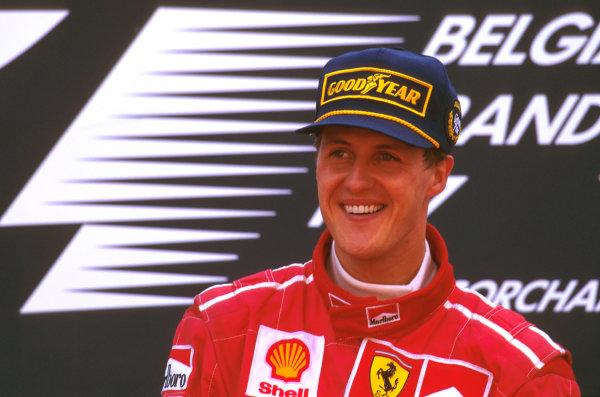 Spa-Francorchamps, Belgium.22-24 August 1997.Michael Schumacher (Ferrari F310B) celebrates 1st position on the podium.Ref-97 BEL 03.World Copyright - LAT Photographic