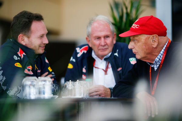 Bahrain International Circuit, Sakhir, Bahrain. Friday 01 April 2016. Christian Horner, Red Bull Racing Team Principal, Helmut Marko, Red Bull Racing Consultant and Niki Lauda, Mercedes Non-Executive Chairman in a meeting. World Copyright: Andy Hone/LAT Photographic ref: Digital Image _ONZ0177