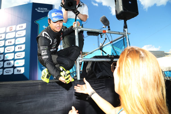 2014/2015 FIA Formula E Championship. Moscow ePrix, Moscow, Russia. Saturday 6 June 2015 Nelson Piquet Jr (BRA)/China Racing - Spark-Renault SRT_01E hands his gloves to Lindsay Lohan on the podium. Photo: Jed Leicester/LAT/Formula E ref: Digital Image JL1_9810