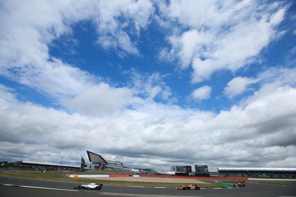Silverstone, Northamptonshire, UK.  Sunday 16 July 2017. Lance Stroll, Williams FW40 Mercedes, leads Fernando Alonso, McLaren MCL32 Honda, and Daniel Ricciardo, Red Bull Racing RB13 TAG Heuer. World Copyright: Charles Coates/LAT Images  ref: Digital Image DJ5R6810