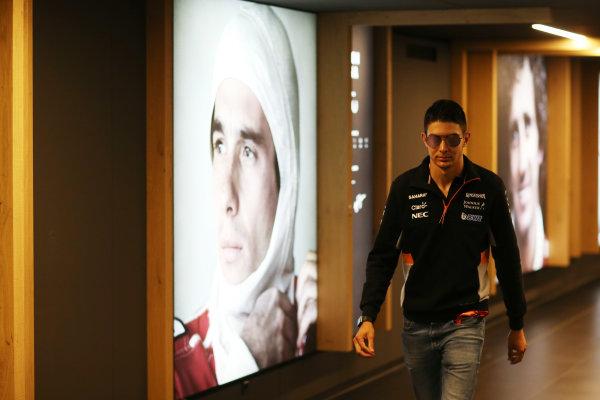 Red Bull Ring, Spielberg, Austria. Sunday 9 July 2017. Esteban Ocon, Force India, walks past a portrait of Ayrton Senna. World Copyright: Charles Coates/LAT Images ref: Digital Image AN7T3476
