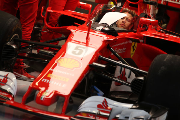 Silverstone, Northamptonshire, UK.  Thursday 13 July 2017. Sebastian Vettel, Ferrari, sits in the cockpit of his car, which is fitted with a new protective windscreen shield. World Copyright: Charles Coates/LAT Images  ref: Digital Image AN7T2052