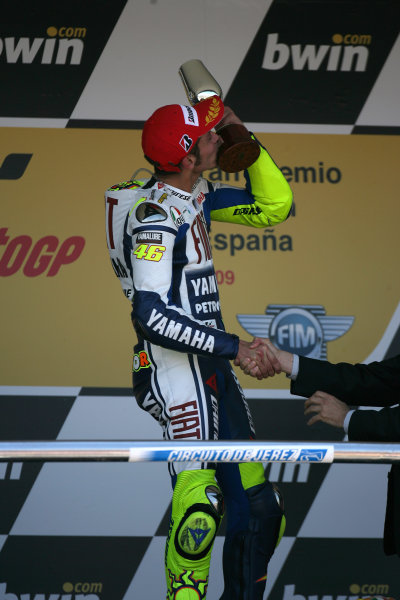 Jerez,Spain.1st - 3rd May 2009.Valentino Rossi Fiat Yamaha Team celebrates his win on the podium by kissing his winners trophyWorld Copyright: Martin Heath/LAT Photographic.ref: BPI_Moto 80si