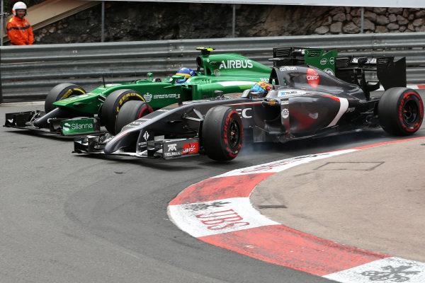 Adrian Sutil (GER) Sauber C33 overtakes Marcus Ericsson (SWE) Caterham CT05. Formula One World Championship, Rd6, Monaco Grand Prix, Race, Monte-Carlo, Monaco, Sunday 25 May 2014. BEST IMAGE
