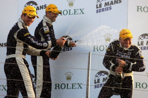 L-R: Stuart Hall (GBR) and Joao Barbosa (POR) spray champagne over Rollcentre Racing team owner/driver Martin Short (GBR).