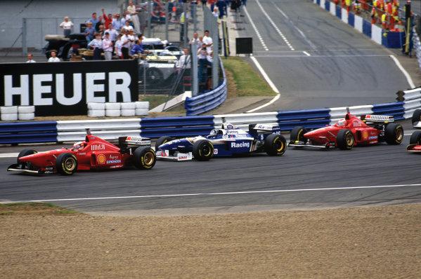 Silverstone, England.12-14 July 1996.Michael Schumacher (Ferrari F310) is followed round Copse by Damon Hill (Williams FW18 Renault) and Eddie Irvine (Ferrari F310).World Copyright: LAT Photographic.Ref:  96 GB 09