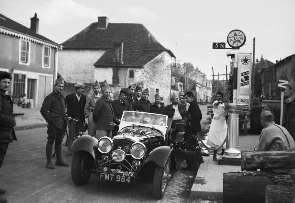 Bremgarten, Berne, Switzerland. 20 August 1939.The photographer stops to refuel his 2 5-litre Jaguar SS en route to the race, atmosphere.World Copyright: Robert Fellowes/LAT PhotographicRef: 39SUI04