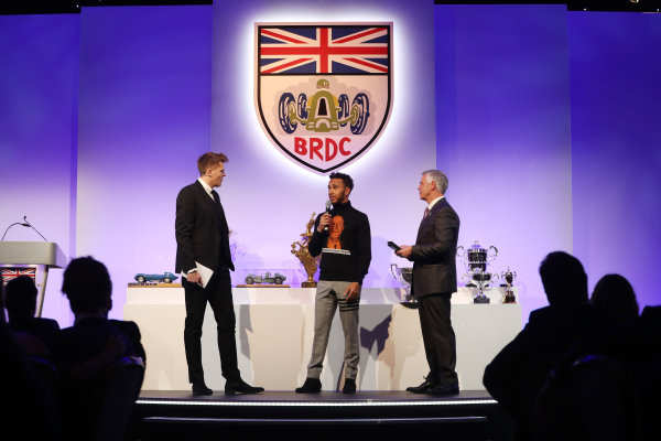 2017 British Racing Drivers Club Awards. London Hilton Hotel, Park Lane, London. Monday 4th December 2017. Lewis Hamilton with Jake Humphrey and Derek Warwick. World Copyright: Jakob Ebrey / LAT Images. Ref: Hamilton-10