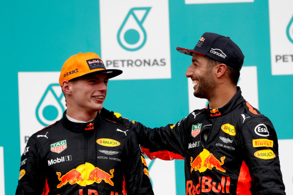 Sepang International Circuit, Sepang, Malaysia. Sunday 1 October 2017. Max Verstappen, Red Bull, 1st Position, and Daniel Ricciardo, Red Bull Racing, 3rd Position, on the podium. World Copyright: Glenn Dunbar/LAT Images  ref: Digital Image _X4I4007